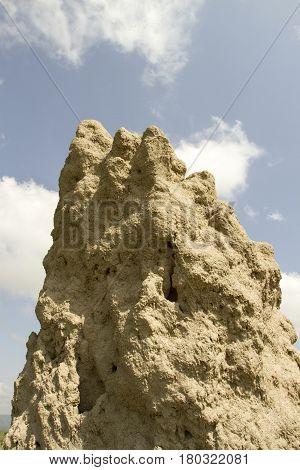 Large termite mound againt blue skies in Tanzania Africa.