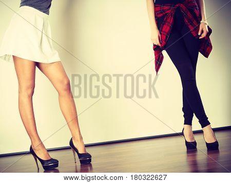 Two Women Legs Presenting High Heels