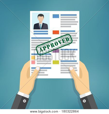 Hand holding resume with Approved stamp mark.