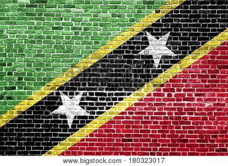 Flag of Saint Kitts And Nevis painted on brick wall, background texture