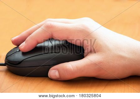 Female Hand on computer mouse and clicking