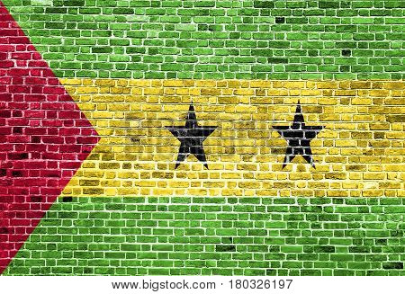 Flag of Sao Tome and Principe painted on brick wall, background texture