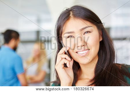 Business woman calling hotline with phone