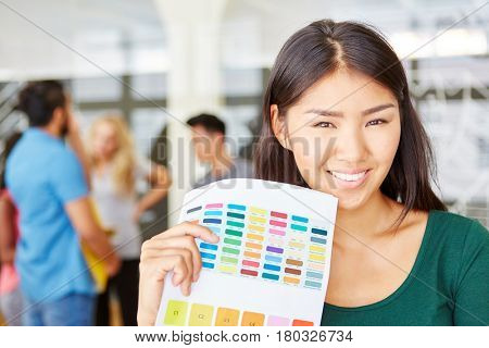 Young woman as creative founder with color palette