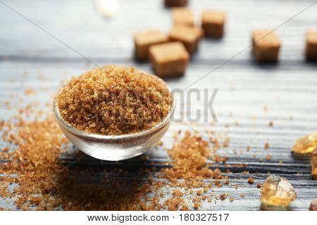 Bowl with brown sugar on wooden table