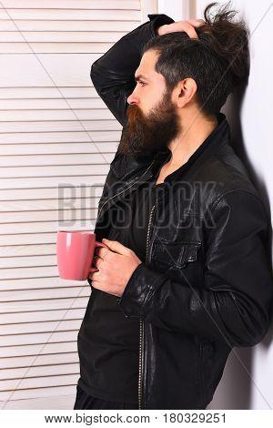 Brutal Caucasian Hipster Holding Cup Or Mug