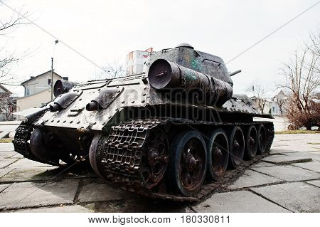poster of Old vintage military tank in the city pedestal.