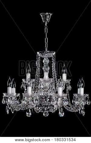 Magnificent lamp on the dark background. Metal is chrome. Large hanging lamp.
