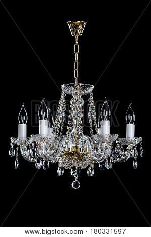 Magnificent gold lamp on the dark background. Large hanging lamp.