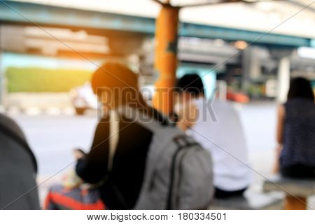 Blurred  Image Of People Waiting At A Bus Stop.