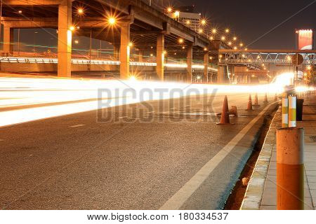]expressway With Light Of Car On Road And Bangkok City With Building And Transportation In Nighttime