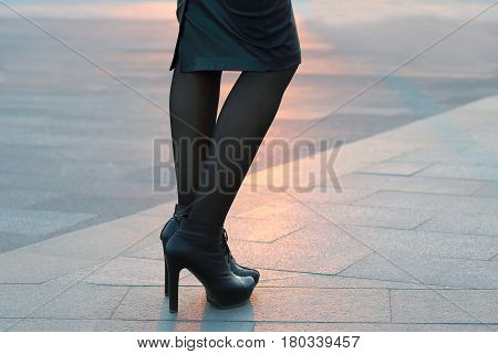 feet girl in black clothes on the street