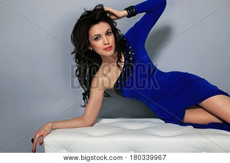 Portrait Of Pretty Fashionable Girl Who Is Lying In The Studio