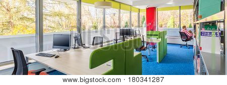 Colorful Library Interior With Desks