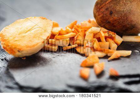 Avocado core Shredder on a slate slab