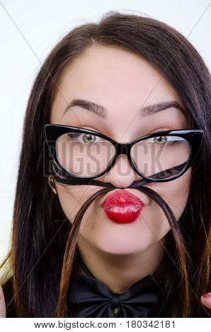 girl is spectacled with a funny mien