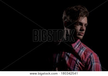 Handsome Man Posing In Red Plaid Tshirt With Arms Folded