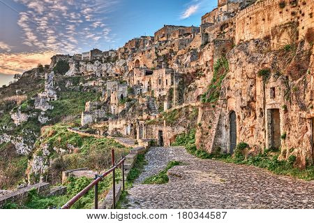 Matera, Basilicata, Italy: landscape at sunrise of the old town (sassi di Matera) with the ancient cave houses carved into the tufa rock over the deep ravine