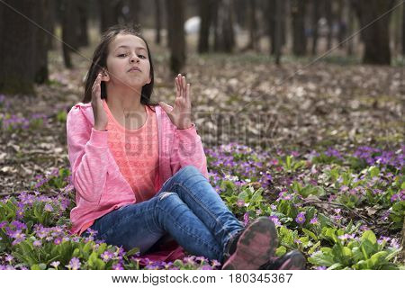 Allergic reaction of a girl in among the flowers