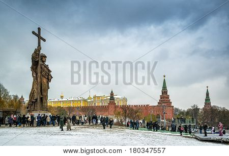 MOSCOW, RUSSIA - NOVEMBER 4, 2016: Monunent to Holy Prince Vladimir the Great on Borovitskaya Square near the Kremlin. Vladimir is credited with the introduction of Orthodox Christianity. People visit the monument on the opening day.