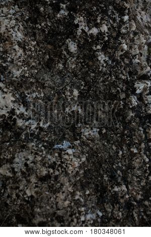 Rock texture and background. Stone background. Abstract texture and background for designers. Abstract stone texture. Closeup view of dark rock. Rough stone macro. Natural texture.