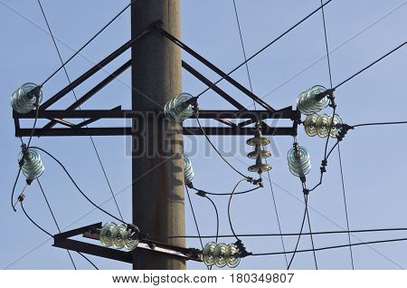 The pole with high voltage wires on sky background. Electricity
