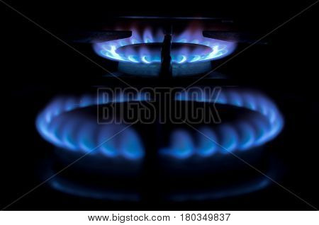 Gas burner on the stove. Gas fire on black background