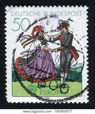 GERMANY- CIRCA 1981: stamp printed in Germany, shows South German couple dancing in regional costumes, circa 1981