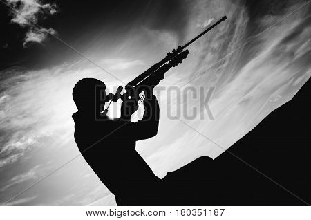 young boy holding and aiming with his camera tripod army concept