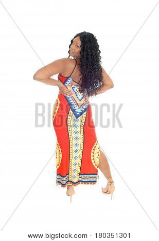 A gorgeous African American woman standing from the back with her hands on her hips with curly black hair isolated for white background.