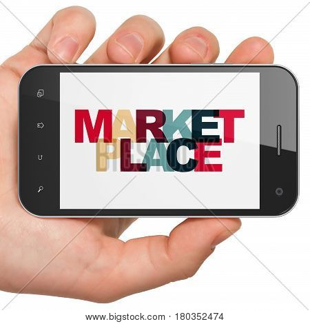 Advertising concept: Hand Holding Smartphone with Painted multicolor text Marketplace on display, 3D rendering