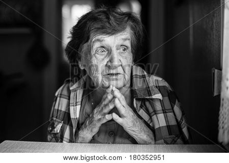 Psychological portrait of an elderly woman, a black-and-white photo.