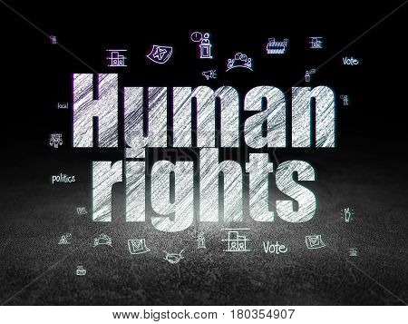 Politics concept: Glowing text Human Rights,  Hand Drawn Politics Icons in grunge dark room with Dirty Floor, black background