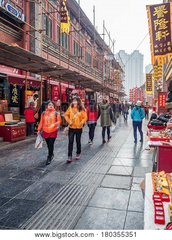 Tianjin, China - Nov 1, 2016: Tianjin Ancient Cultural Street; shop buildings preserved in the classical Qing Dynasty architectural style. Morning scene to what is a very popular tourist area.