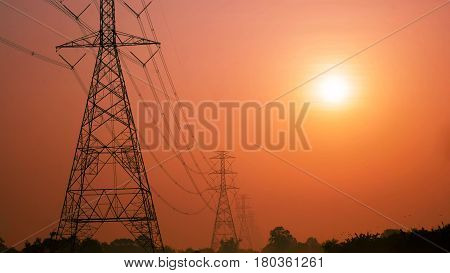 high voltage post.High-voltage tower with sunrise Nature background