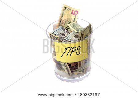 Tip Jar. Tip Jar stuffed with money. Isolated on white with room for your text.
