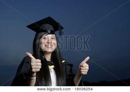 Happy asian graduate lady