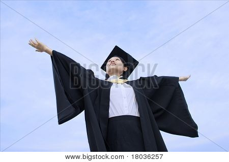 Asian graduate lady outstretched arms
