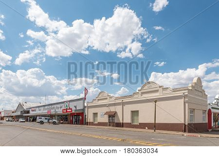 MIDDELBURG SOUTH AFRICA - MARCH 21 2017: A street scene with the historic old public library and a supermarket in Middelburg a town in the Eastern Cape Province