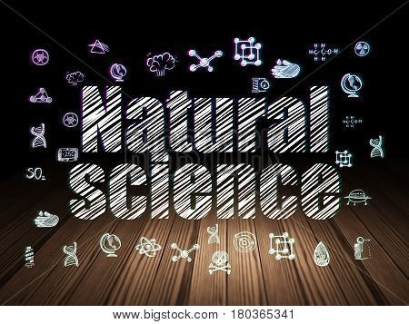 Science concept: Glowing text Natural Science,  Hand Drawn Science Icons in grunge dark room with Wooden Floor, black background