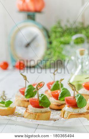 Crisp Crostini With Tomato, Mozzarella And Basil For A Snack