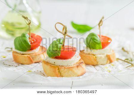 Fresh Crostini With Tomato, Mozzarella And Basil For A Snack