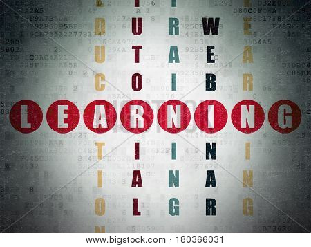 Learning concept: Painted red word Learning in solving Crossword Puzzle on Digital Data Paper background