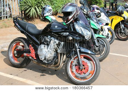 Parked Motorbikes At Yearly Mass Ride With Black Suzuki Racing Bike