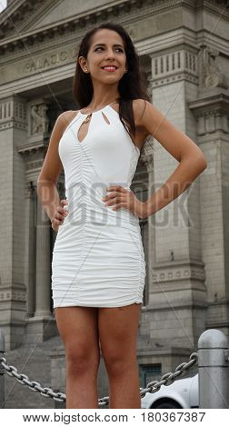 Beautiful Woman At Library Or Courthouse Wearing A White Dress