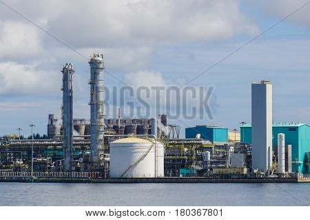 View of the Oil and gas industry,refinery factory petrochemical plant  showing main-station of pipelines and towers in Labuan Pearl of Borneo,Malaysia