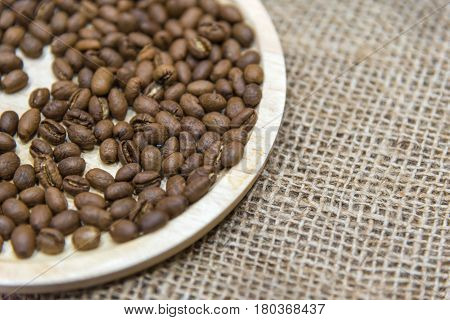 Coffee Beans In Wooden Tray On The Sack Cloth