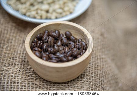 Coffee Beans In Wooden Bowl On The Sack Cloth