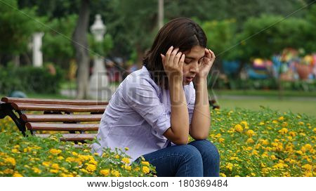 Distraught Stressed Teen Girl Sitting on a Park Bench