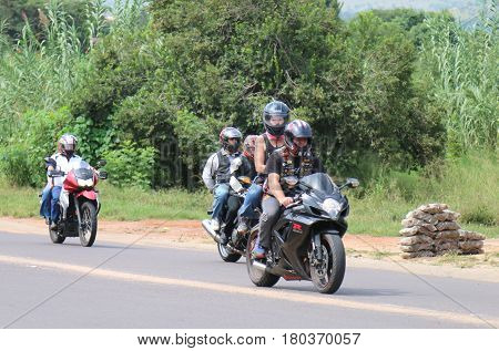 Motorbikes Travelling Through City Streets At Yearly Mass Ride